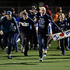 """Longmont students rush the field after the game at Longmont High School on Friday, Nov. 2, 2012.  Longmont beat Greeley Central 42-25. For more photos visit  <a href=""""http://www.BoCoPreps.com"""">http://www.BoCoPreps.com</a>.<br /> (Greg Lindstrom/Times-Call)"""