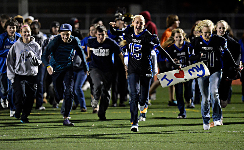 "Longmont students rush the field after the game at Longmont High School on Friday, Nov. 2, 2012.  Longmont beat Greeley Central 42-25. For more photos visit  <a href=""http://www.BoCoPreps.com"">http://www.BoCoPreps.com</a>.<br /> (Greg Lindstrom/Times-Call)"