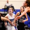 Silver Creek High School's Taylor Strub (No. 11) and Carrie Ramirez (No. 22) tries to box out Longmont High School's Megan Tulenko (No. 32), Friday, Feb. 22, 2013, at LHS.<br /> (Matthew Jonas/Times-Call)