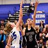Silver Creek High School's Emilie Rembert (No. 5) puts up a shot past Longmont High School's Sydney Wetterstrom (No. 15), Friday, Feb. 22, 2013, at LHS.<br /> (Matthew Jonas/Times-Call)