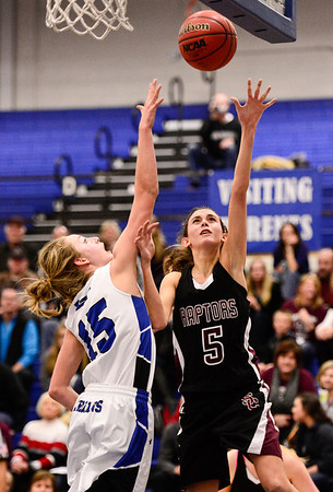 Silver Creek High School's Emilie Rembert (No. 5) puts up a shot past Longmont High School's Sydney Wetterstrom (No. 15), Friday, Feb. 22, 2013, at LHS.<br /> (Matthew Jonas/Times-Call)