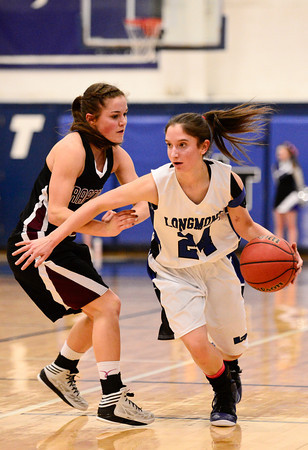 Longmont High School's Anna Schell (No. 24) drives around Silver Creek High School's Margaret Davis (No. 3), Friday, Feb. 22, 2013, at LHS.<br /> (Matthew Jonas/Times-Call)