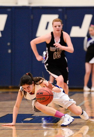Longmont High School's Lydia Pane (No. 33) slides out while chasing down the ball, Friday, Feb. 22, 2013, at LHS.<br /> (Matthew Jonas/Times-Call)