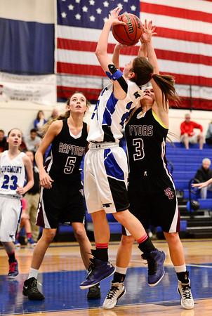 Longmont High School's Anna Schell (No. 24) puts up a shot between Silver Creek High School's Margaret Davis (No. 3) and Emilie Rembert (No. 5), Friday, Feb. 22, 2013, at LHS.<br /> (Matthew Jonas/Times-Call)