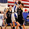 Longmont High School's Anna Schell (No. 24) puts up a shot between Silver Creek High School's Margaret Davis (No. 3) and Emilie Rembert (No. 5), Friday, Feb. 22, 2013, at LHS.<br /> (Matthew Jonas/Times-Call)