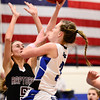 Longmont High School's Gabriella Fallon (No. 3) puts up a shot over Silver Creek High School's Emilie Rembert (No. 5), Friday, Feb. 22, 2013, at LHS.<br /> (Matthew Jonas/Times-Call)