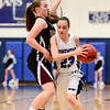 Longmont High School's Kathryn Schell (No. 23) tries to get past Silver Creek High School's Shelby Keil (No. 20), Friday, Feb. 22, 2013, at LHS.<br /> (Matthew Jonas/Times-Call)