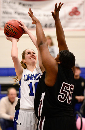 Longmont High School's Hanna Carney (No. 10) tries to put a shot past the defense of  Silver Creek High School's Grace Reed (No. 50), Friday, Feb. 22, 2013, at LHS.<br /> (Matthew Jonas/Times-Call)