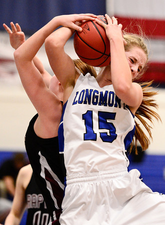 Longmont High School's Sydney Wetterstrom (No. 15) battles for a rebound with Silver Creek High School's Julie Dauer (No. 12), Friday, Feb. 22, 2013, at LHS.<br /> (Matthew Jonas/Times-Call)