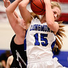 Longmont High School's Sydney Wetterstrom (No. 15) battles for a rebound with Silver Creek High School's Julie Dauer (No. 12), Friday, Feb. 22, 2013, at LHS.<br /> (Matthew Jonas/Times-Call)