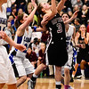 Silver Creek High School's Margaret Davis (No. 3) breaks through Longmont High School's defense to take a shot, Friday, Feb. 22, 2013, at LHS.<br /> (Matthew Jonas/Times-Call)