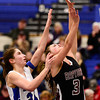 Longmont High School's Anna Schell (No. 24) tries to block a shot from Silver Creek High School's Margaret Davis (No. 3), Friday, Feb. 22, 2013, at LHS.<br /> (Matthew Jonas/Times-Call)
