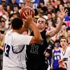 Silver Creek High School's Zane Lindsey (No. 11) tries to block a pass Longmont High School's Marcus Johnson (No. 43), Friday, Feb. 22, 2013, at LHS.<br /> (Matthew Jonas/Times-Call)