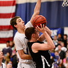 Longmont High School's Justinian Jessup (No. 10) tries to block a shot from Silver Creek High School's Zane Lindsey (No. 11), Friday, Feb. 22, 2013, at LHS.<br /> (Matthew Jonas/Times-Call)