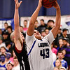 Longmont High School's Marcus Johnson (No. 43) puts up a shot past Silver Creek High School's Luke Goforth (No. 32), Friday, Feb. 22, 2013, at LHS. The Trojans defeated the Raptors, 54-42.<br /> (Matthew Jonas/Times-Call)