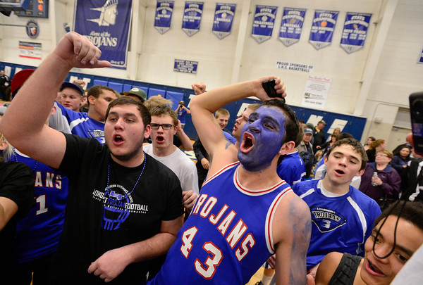 Longmont High School fans celebrate their victory over Silver Creek High School, Friday, Feb. 22, 2013, at LHS.<br /> (Matthew Jonas/Times-Call)