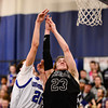 Silver Creek High School's Brock Johnson (No. 23) collides with Longmont High School's Austin Kemp (No. 21) while battling for a rebound, Friday, Feb. 22, 2013, at LHS.<br /> (Matthew Jonas/Times-Call)