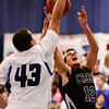 Silver Creek High School's Trey Fleming (No. 12) stretches to put up a shot by Longmont High School's Marcus Johnson (No. 43) , Friday, Feb. 22, 2013, at LHS.<br /> (Matthew Jonas/Times-Call)