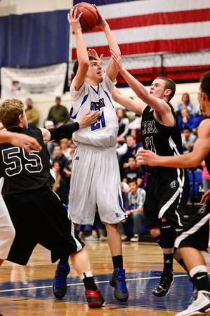 Longmont High School's Austin Kemp (No. 21) looks to shoot while covered by Silver Creek High School's Francisco Echevarria (No. 55) and Zane Lindsey (No. 11), Friday, Feb. 22, 2013, at LHS.<br /> (Matthew Jonas/Times-Call)