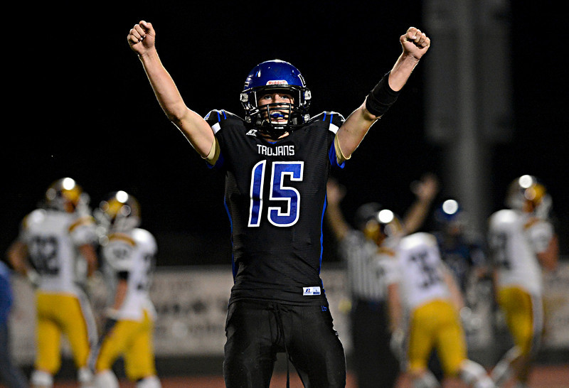 """Longmont's Forrest Wetterstrom celebrates a second-half touchdown against Windsor.  Longmont hosts Windsor during homecoming at Everly-Montgomery Field in Longmont on Friday, Sept. 28, 2012.  For more photos visit  <a href=""""http://www.BoCoPreps.com"""">http://www.BoCoPreps.com</a>.<br /> (Greg Lindstrom/Times-Call)"""
