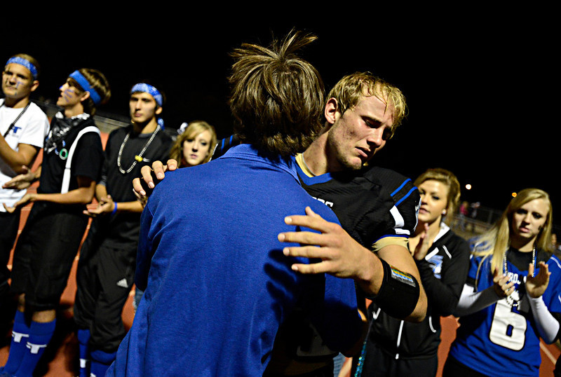 """Longmont's Forrest Wetterstrom hugs fellow senior Roger Patterson after the game.  Windsor beat Longmont 27-17 at Everly-Montgomery Field in Longmont on Friday, Sept. 28, 2012.  For more photos visit  <a href=""""http://www.BoCoPreps.com"""">http://www.BoCoPreps.com</a>.<br /> (Greg Lindstrom/Times-Call)"""