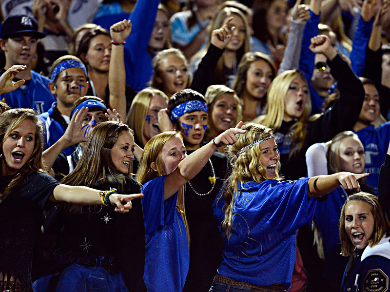 """Trojan fans cheer on their team in the first half.  Longmont hosts Windsor during homecoming at Everly-Montgomery Field in Longmont on Friday, Sept. 28, 2012.  For more photos visit  <a href=""""http://www.BoCoPreps.com"""">http://www.BoCoPreps.com</a>.<br /> (Greg Lindstrom/Times-Call)"""