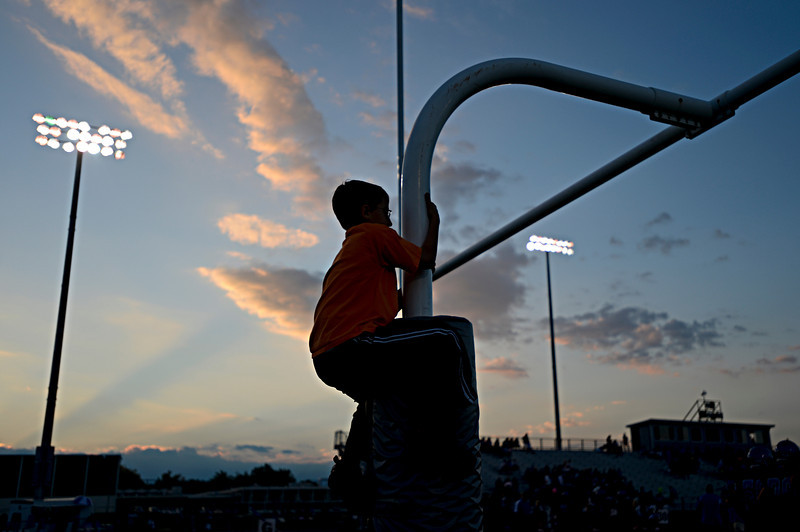 """Blake Madden, 9, climbs the goalposts before the game at Longmont High School.  Windsor beat Longmont 27-17 at Everly-Montgomery Field in Longmont on Friday, Sept. 28, 2012.  For more photos visit  <a href=""""http://www.BoCoPreps.com"""">http://www.BoCoPreps.com</a>.<br /> (Greg Lindstrom/Times-Call)"""