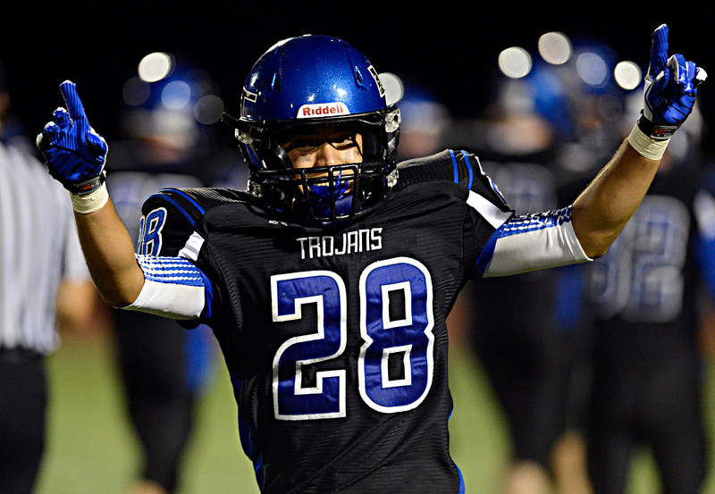 """Longmont's Marcus Vasquez (28) celebrates after recovering a Windsor fumble in the second half.  Windsor beat Longmont 27-17 at Everly-Montgomery Field in Longmont on Friday, Sept. 28, 2012.  For more photos visit  <a href=""""http://www.BoCoPreps.com"""">http://www.BoCoPreps.com</a>.<br /> (Greg Lindstrom/Times-Call)"""