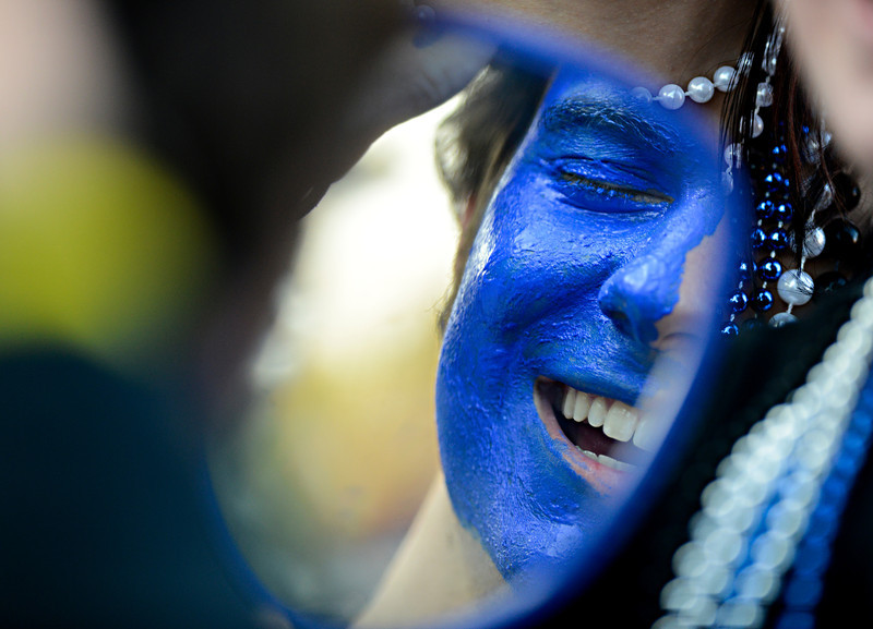 """Longmont senior Dan Kiemele laughs while having his face painted by Sierra Baumann before the game at Longmont High School.  Windsor beat Longmont 27-17 at Everly-Montgomery Field in Longmont on Friday, Sept. 28, 2012.  For more photos visit  <a href=""""http://www.BoCoPreps.com"""">http://www.BoCoPreps.com</a>.<br /> (Greg Lindstrom/Times-Call)"""