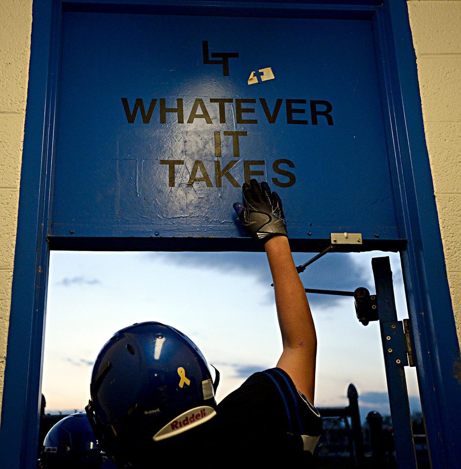 """Longmont players take the field before the game at Longmont High School.  Windsor beat Longmont 27-17 at Everly-Montgomery Field in Longmont on Friday, Sept. 28, 2012.  For more photos visit  <a href=""""http://www.BoCoPreps.com"""">http://www.BoCoPreps.com</a>.<br /> (Greg Lindstrom/Times-Call)"""