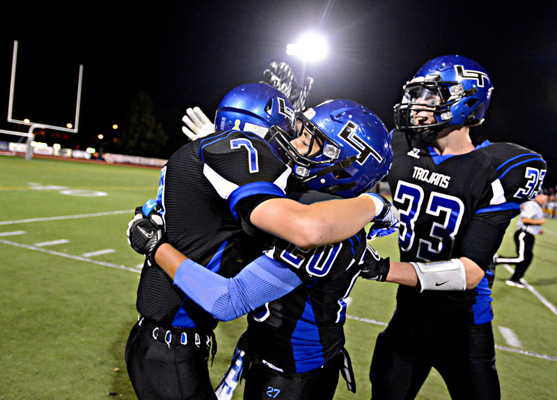 "Longmont players, left to right, David Speidel, Jamal Mamgelsen and Mitch Speidel celebrate a 88-yard kick return by David Speidel in the first half.  A penalty on the play negated the touchdown.  Longmont hosts Windsor during homecoming at Everly-Montgomery Field in Longmont on Friday, Sept. 28, 2012.  For more photos visit  <a href=""http://www.BoCoPreps.com"">http://www.BoCoPreps.com</a>.<br /> (Greg Lindstrom/Times-Call)"