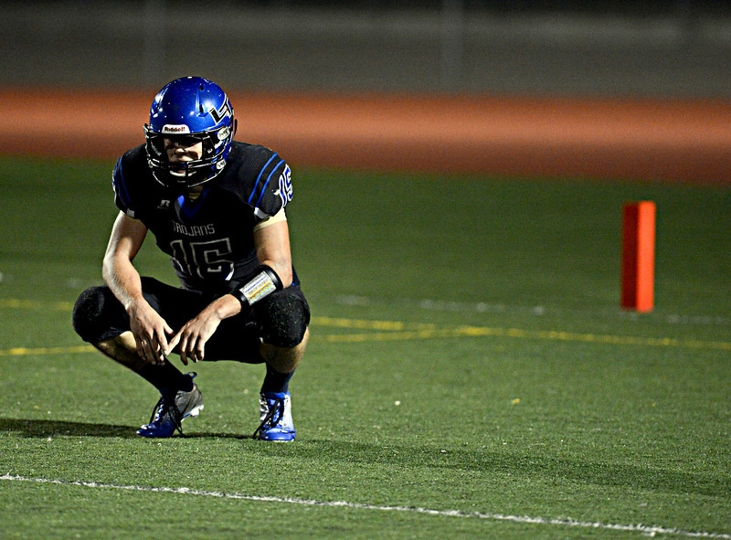 """Longmont's Forrest Wetterstrom reacts after throwing an interception in the fourth quarter.  Windsor beat Longmont 27-17 at Everly-Montgomery Field in Longmont on Friday, Sept. 28, 2012.  For more photos visit  <a href=""""http://www.BoCoPreps.com"""">http://www.BoCoPreps.com</a>.<br /> (Greg Lindstrom/Times-Call)"""