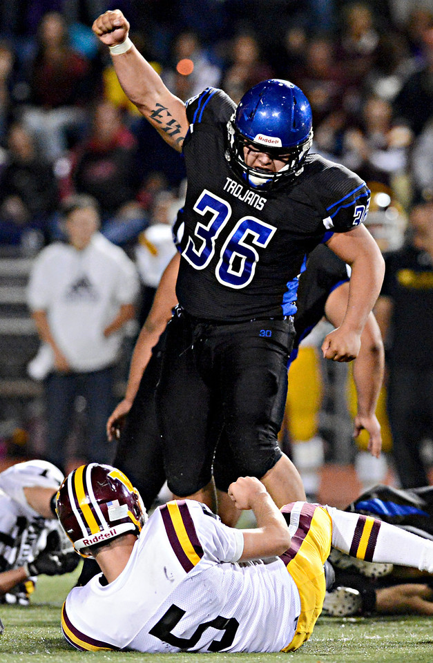 """Longmont's Joe Lopez (36) celebrates after forcing a fumble in the first half.  The fumble was recovered by Longmont's David Speidel.  Longmont hosts Windsor during homecoming at Everly-Montgomery Field in Longmont on Friday, Sept. 28, 2012.  For more photos visit  <a href=""""http://www.BoCoPreps.com"""">http://www.BoCoPreps.com</a>.<br /> (Greg Lindstrom/Times-Call)"""