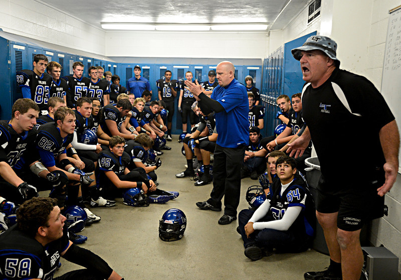 """Longmont coaches try to pump their team up before the game.  Windsor beat Longmont 27-17 at Everly-Montgomery Field in Longmont on Friday, Sept. 28, 2012.  For more photos visit  <a href=""""http://www.BoCoPreps.com"""">http://www.BoCoPreps.com</a>.<br /> (Greg Lindstrom/Times-Call)"""