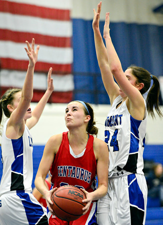 "Centaurus' Anna Hubbell, center, goes up for a shot as Longmont's Gabriella Fallon, left, and Anna Schell defend during the game at Longmont High School on Friday, Jan. 18, 2013. Centaurus beat Longmont 41-36. For more photos visit  <a href=""http://www.BoCoPreps.com"">http://www.BoCoPreps.com</a>.<br /> (Greg Lindstrom/Times-Call)"