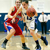"""Longmont's Kathryn Schell, right, drives past Centaurus' Anna Hubbell during the game at Longmont High School on Friday, Jan. 18, 2013. Centaurus beat Longmont 41-36. For more photos visit  <a href=""""http://www.BoCoPreps.com"""">http://www.BoCoPreps.com</a>.<br /> (Greg Lindstrom/Times-Call)"""