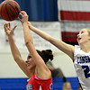 """Longmont's Alexis Cox (22) reaches for a rebound over Centaurus' Gianna Manfredini (10) during the game at Longmont High School on Friday, Jan. 18, 2013. Centaurus beat Longmont 41-36. For more photos visit  <a href=""""http://www.BoCoPreps.com"""">http://www.BoCoPreps.com</a>.<br /> (Greg Lindstrom/Times-Call)"""