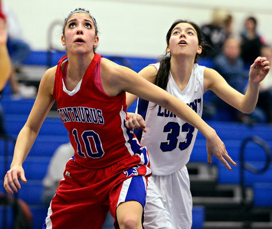 """Centaurus' Gianna Manfredini (10) boxes out Longmont's Lydia Pane (33) during the game at Longmont High School on Friday, Jan. 18, 2013. Centaurus beat Longmont 41-36. For more photos visit  <a href=""""http://www.BoCoPreps.com"""">http://www.BoCoPreps.com</a>.<br /> (Greg Lindstrom/Times-Call)"""