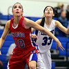 "Centaurus' Gianna Manfredini (10) boxes out Longmont's Lydia Pane (33) during the game at Longmont High School on Friday, Jan. 18, 2013. Centaurus beat Longmont 41-36. For more photos visit  <a href=""http://www.BoCoPreps.com"">http://www.BoCoPreps.com</a>.<br /> (Greg Lindstrom/Times-Call)"