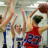"""Longmont's Gabriella Fallon (3) and Anna Schell (24) trap Centaurus' Anna Hubbell (23) during the game at Longmont High School on Friday, Jan. 18, 2013. Centaurus beat Longmont 41-36. For more photos visit  <a href=""""http://www.BoCoPreps.com"""">http://www.BoCoPreps.com</a>.<br /> (Greg Lindstrom/Times-Call)"""