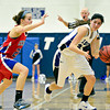 """Longmont's Lydia Pane, right, tries to drive past Centaurus' Anna Hubbell during the game at Longmont High School on Friday, Jan. 18, 2013. Centaurus beat Longmont 41-36. For more photos visit  <a href=""""http://www.BoCoPreps.com"""">http://www.BoCoPreps.com</a>.<br /> (Greg Lindstrom/Times-Call)"""