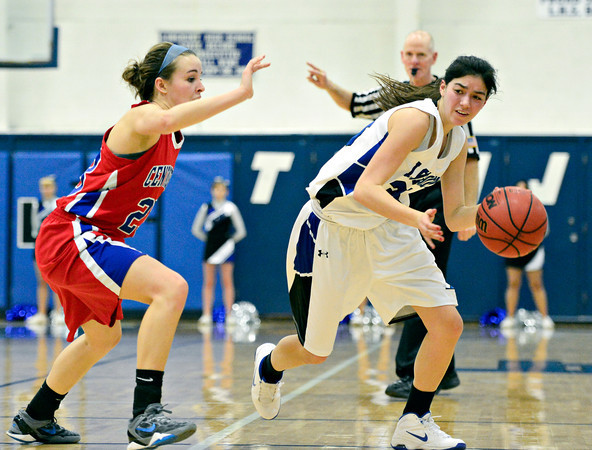 "Longmont's Lydia Pane, right, tries to drive past Centaurus' Anna Hubbell during the game at Longmont High School on Friday, Jan. 18, 2013. Centaurus beat Longmont 41-36. For more photos visit  <a href=""http://www.BoCoPreps.com"">http://www.BoCoPreps.com</a>.<br /> (Greg Lindstrom/Times-Call)"