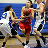 "Centaurus' Danelle Dondelinger (21) tries to control the ball as Longmont's Lydia Pane (33) and Kathryn Schell (23) defend during the game at Longmont High School on Friday, Jan. 18, 2013. Centaurus beat Longmont 41-36. For more photos visit  <a href=""http://www.BoCoPreps.com"">http://www.BoCoPreps.com</a>.<br /> (Greg Lindstrom/Times-Call)"