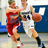 """Longmont's Anna Schell, right, drives past Centaurus' Lauren Esler during the game at Longmont High School on Friday, Jan. 18, 2013. Centaurus beat Longmont 41-36. For more photos visit  <a href=""""http://www.BoCoPreps.com"""">http://www.BoCoPreps.com</a>.<br /> (Greg Lindstrom/Times-Call)"""