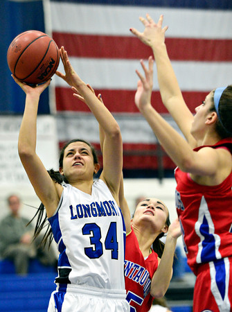 "Longmont's Dailyn Johnson (34) shoots over Centaurus defenders during the game at Longmont High School on Friday, Jan. 18, 2013. Centaurus beat Longmont 41-36. For more photos visit  <a href=""http://www.BoCoPreps.com"">http://www.BoCoPreps.com</a>.<br /> (Greg Lindstrom/Times-Call)"