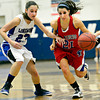 "Centaurus' Danelle Dondelinger (21) drives past Longmont's Kathryn Schell (23) during the game at Longmont High School on Friday, Jan. 18, 2013. Centaurus beat Longmont 41-36. For more photos visit  <a href=""http://www.BoCoPreps.com"">http://www.BoCoPreps.com</a>.<br /> (Greg Lindstrom/Times-Call)"