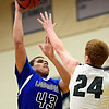 "Longmont's Marcus Johnson (43) shoots over D'Evelyn's Grant Witherspoon (24) during the game at D'Evelyn High School on Saturday, March 2, 2013. Longmont lost to D'Evelyn 72-58. For more photos visit  <a href=""http://www.BoCoPreps.com"">http://www.BoCoPreps.com</a>.<br /> (Greg Lindstrom/Times-Call)"