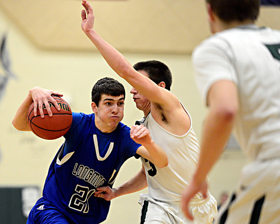 "Longmont's Austin Kemp (21) drives past D'Evelyn's Connor Skelton (3) during the game at D'Evelyn High School on Saturday, March 2, 2013. Longmont lost to D'Evelyn 72-58. For more photos visit  <a href=""http://www.BoCoPreps.com"">http://www.BoCoPreps.com</a>.<br /> (Greg Lindstrom/Times-Call)"