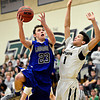 "Longmont's Eli Sullivan (23) goes up for a shot over D'Evelyn's Ty Mcgee (1) during the game at D'Evelyn High School on Saturday, March 2, 2013. Longmont lost to D'Evelyn 72-58. For more photos visit  <a href=""http://www.BoCoPreps.com"">http://www.BoCoPreps.com</a>.<br /> (Greg Lindstrom/Times-Call)"
