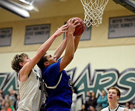"Longmont's Marcus Johnson (43) grabs a rebound over D'Evelyn's Cody Marvel (4) during the game at D'Evelyn High School on Saturday, March 2, 2013. Longmont lost to D'Evelyn 72-58. For more photos visit  <a href=""http://www.BoCoPreps.com"">http://www.BoCoPreps.com</a>.<br /> (Greg Lindstrom/Times-Call)"